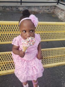 Young girl eating an ice cream cone